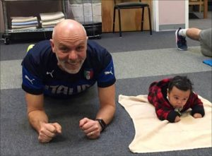 Mark Rossignol doing planks with his grandson Kingston.
